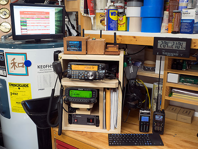 My radios and hotspots sitting on the corner of my workshop desk
